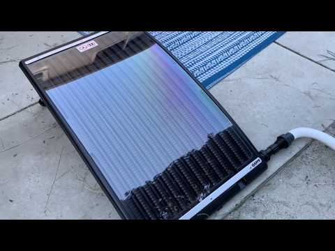GAME solar panel attached to Coleman above ground pool