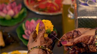 Diwali decoration - Woman / female making garland with fresh flowers