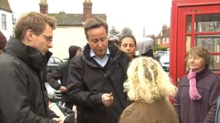 David Cameron meets a victim of flooding in Yalding