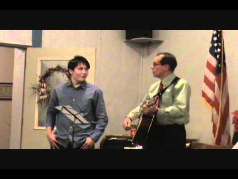 Joe Ellis and Axel Garcia singing Feliz Navidad