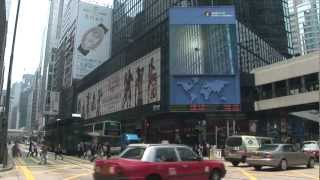 Hong Kong Streets with Jumbotron Large-Screen TV Television People Buses Taxis HK Trams and Shops