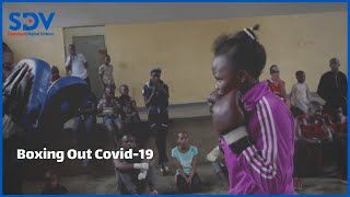A group of children in a Nairobi settlement are learning to box while they are stuck at home