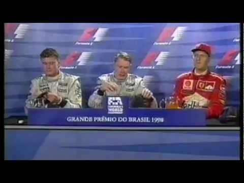 Michael Schumacher flirts during the Press Conference
