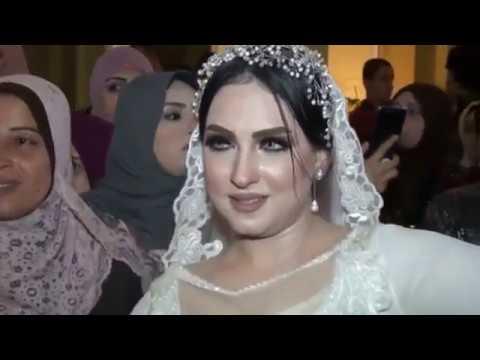 Arabic hot wedding dancing between bride and groom
