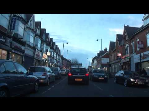 A car drive along Stratford Road, around the Sparkhill District and along Ladypool Road, Birmingham.