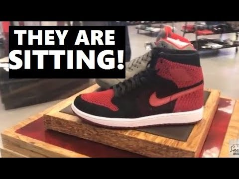 low priced b83be 5d478 Air Jordan 1 BANNED Flyknit Sneakers SITTING on Shelves