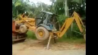 Loading a Backhoe Into a Dump Truck Like a Boss
