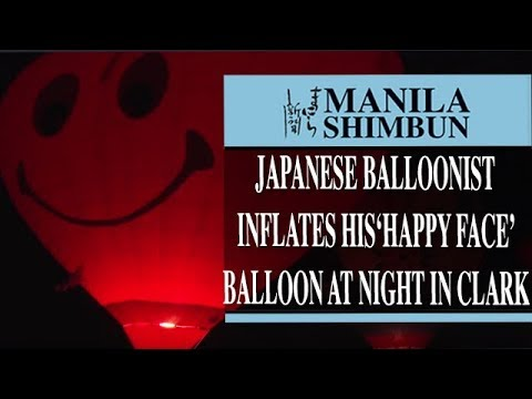 Watch: Japanese balloonist inflates his 'happy face' balloon at night in Clark