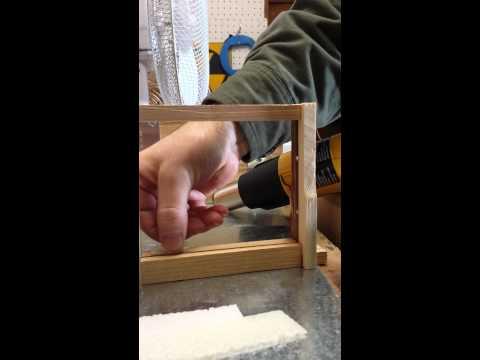 Installing wax starter strips in Eco Bee Box Mini