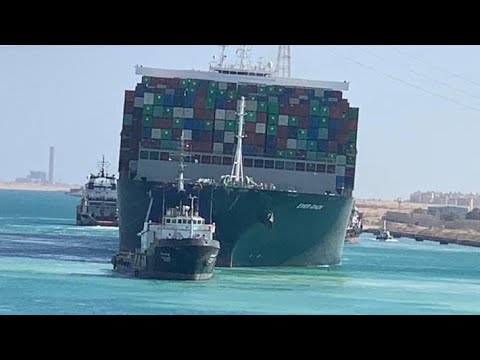 Suez Canal: Tugboats sound horns as Ever Given container ship 'fully refloated'