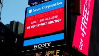 New York Post headlines tour ad at Times Square