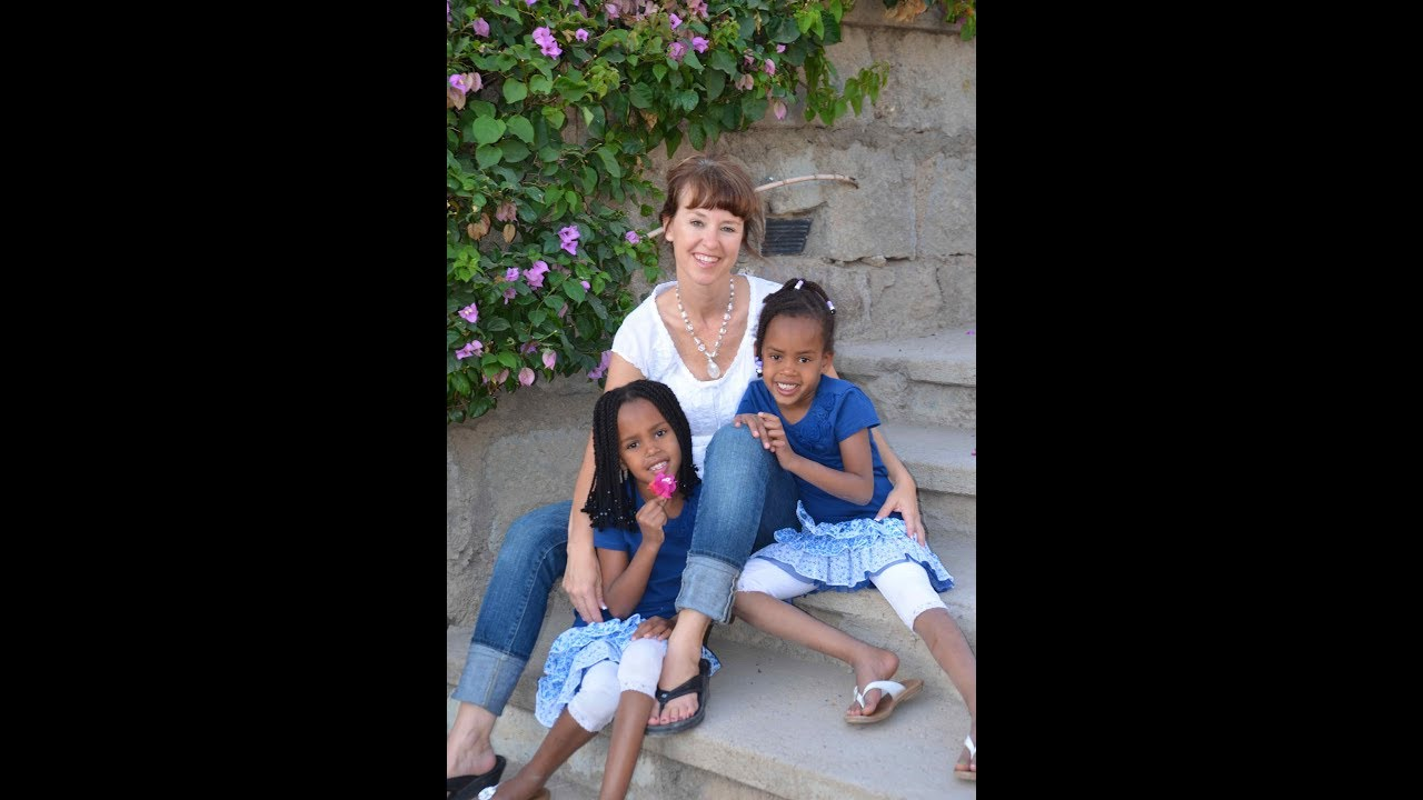 Twin girl's 1st trip back to Ethiopia, 4 yrs post adoption. (2012)
