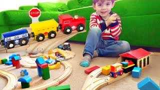 Little Boy Playing with Wooden Railway Set & Wooden Engines Trains, Cars