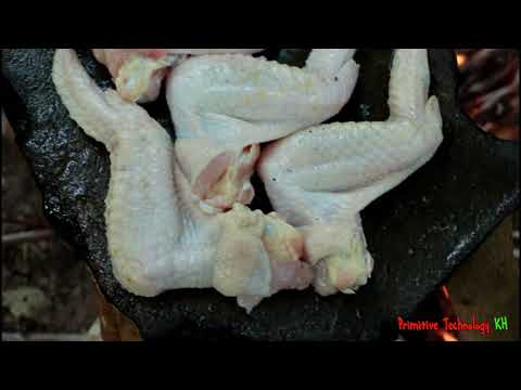 Primitive Technology - Eating delicious - Cooking chicken wing on a rock