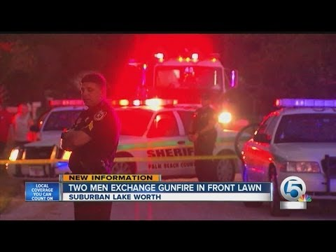 Two men exchange gunfire in front law