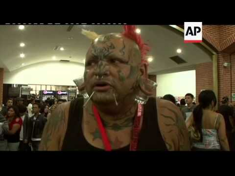 The Art Of Tattooing And Body Piercing Taken To Extremes At Expo
