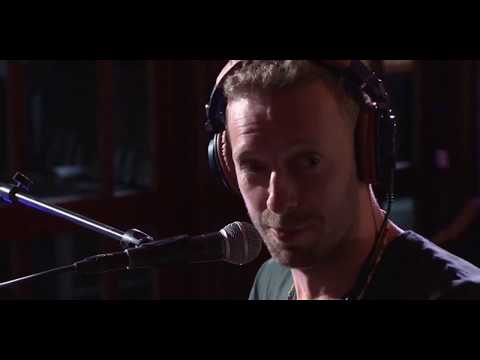 Chris Martin performing Yellow on the BBC  Radio 1 Live Lounge