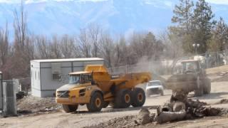 Volvo A40F Dump Truck dumping a load and driving the construction site