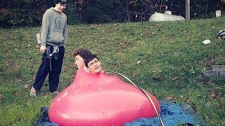 giant 6ft water balloon shot with paintball guns   2 men in 1 balloon   slow mo water balloon pop