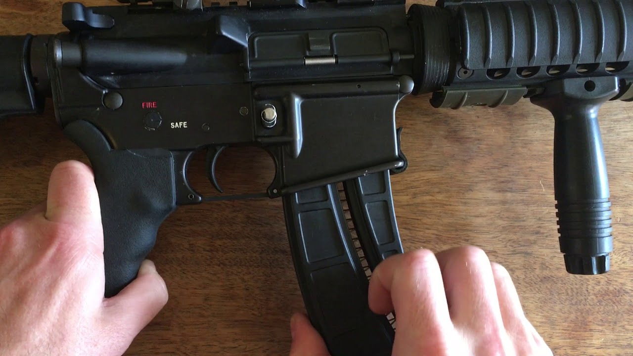 AR 15 22lr last round bolt hold open solutions: Catch-22 and
