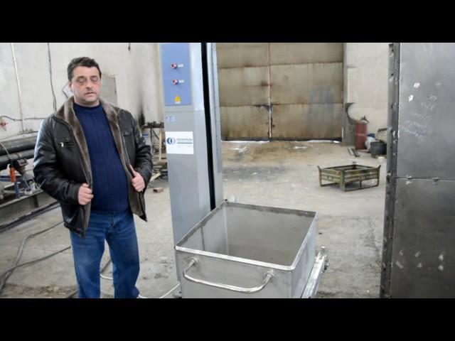 Подъемник-опрокидыватель для тележек