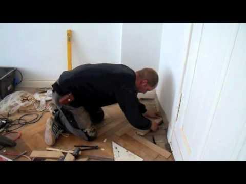 restoring-a-wooden-floor,-reparing-herringbone-parquet,-sanding-hardwood-parquet