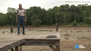 Lake disappears overnight, neighbors blame rainstorms.
