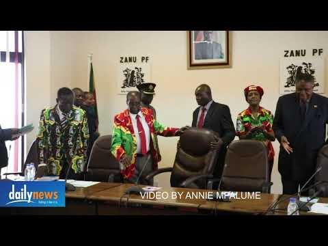 President Mugabe walks into the Zanu PF politburo meeting