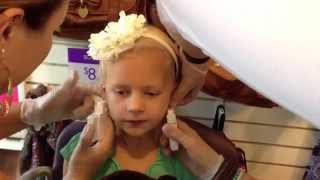 Ear Piercing at Claire