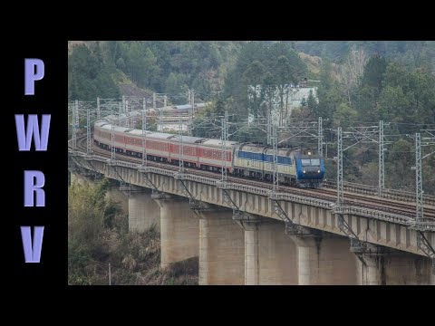 Chinese Diesels - DF11G flies over Laocheng viaduct with a 17 car train Jan 16 2013