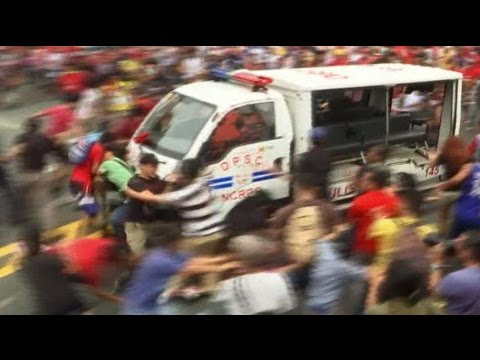 Police van runs over protesters at anti-US rally