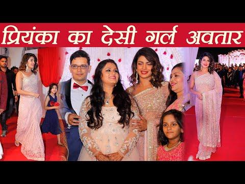 Priyanka Chopra looks beautiful in Designer Pink Saree at wedding reception; Watch Video | FilmiBeat