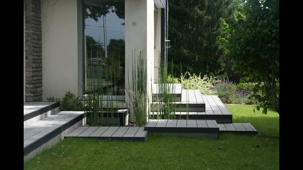 Am nagement d 39 une terrasse en bois composite gris chamarr youtube for Amenagement jardin contemporain