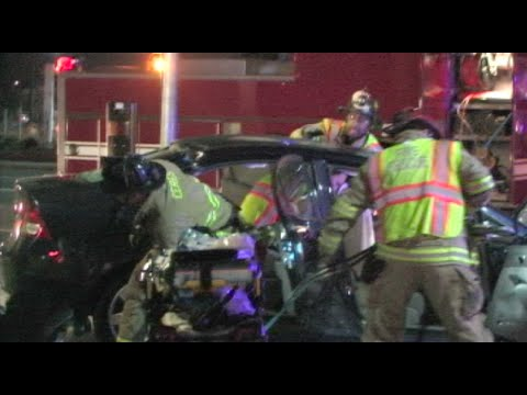 Firefighters Rescue a Woman Pinned in a Car After Crash - Caught On Camera