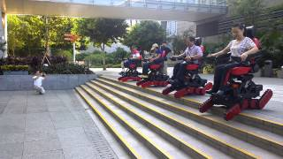 Wheelchair users' outdoor fun with Stair-Climbing B-Free chair, amazing group down stair scene