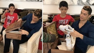 Cristiano Ronaldo with son open box with new CR7 NIKE AF1 24k gold