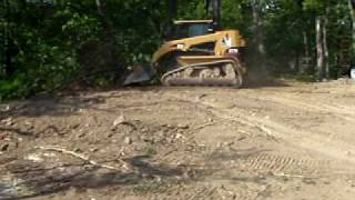 Alderman Enterprise Cat Rubber Track Loader pushing dirt over and grading