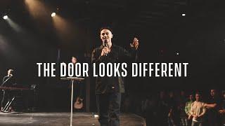 The Door Looks Different - Charles Metcalf