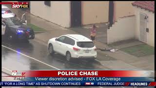 STRIP AHEAD OF ARREST: Woman exits car, removes clothes following LA police chase (FNN)