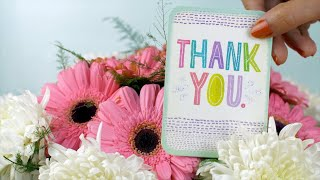 Closeup shot - Thank you message card with a fresh bouquet of pink and white flowers
