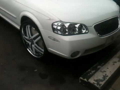 Nissan Maxima on 24 inch DUB Delusion Floaters