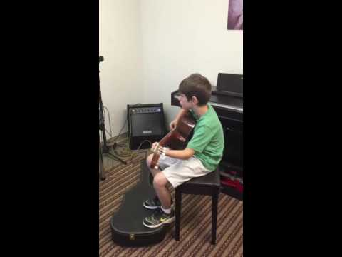 Guitar lesson at Virtuoso School of Music and Art