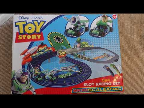Playing with the Scalextric Disney-Pixar Toy Story Car Slot Racing Toy set