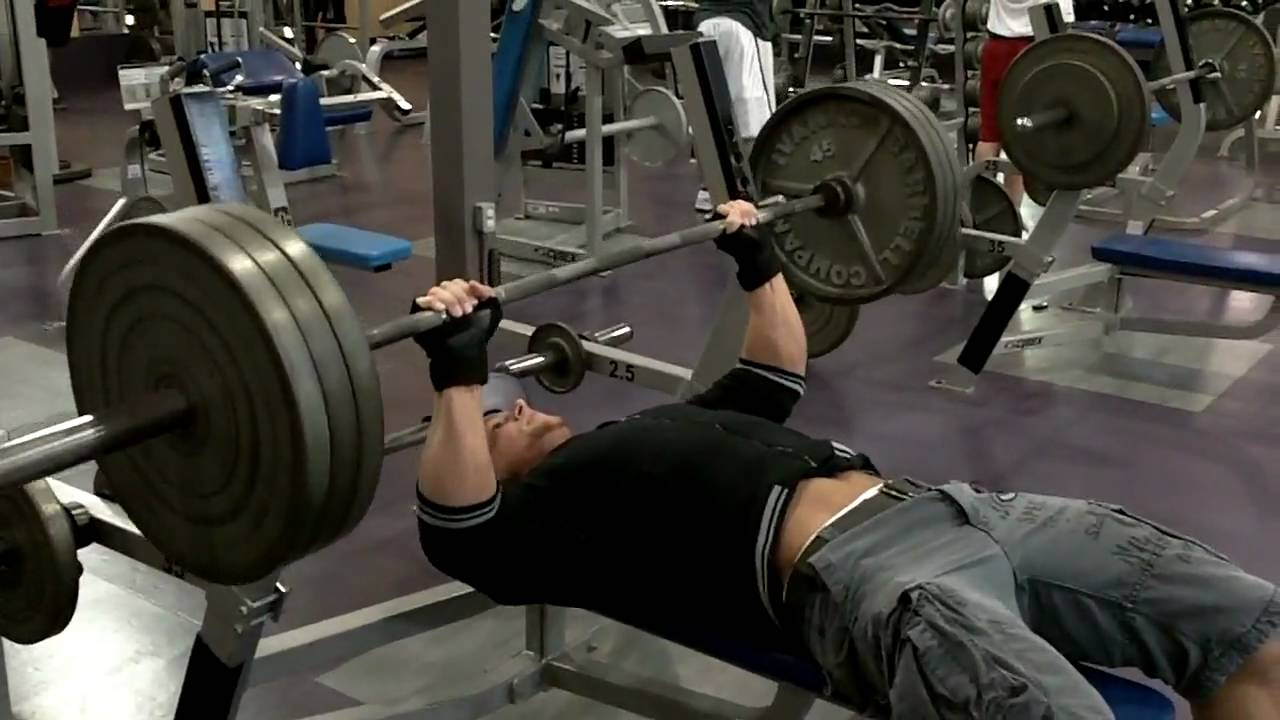 Benching 315lbs (3 Plates) for 4 Reps