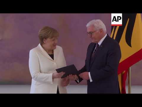 German president officially appoints Merkel as chancellor