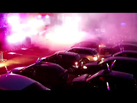 Germans get the party started at physically distanced drive-in rave