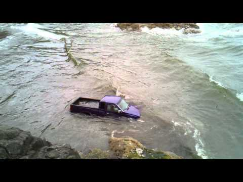 Failed truck driving in ocean