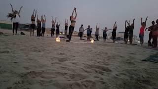 Sunset yoga on the beach, Dubai, UAE