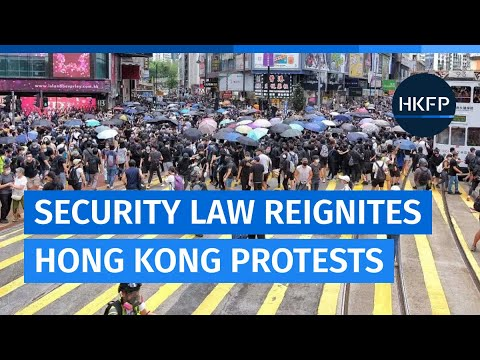 Hong Kong police and protesters clash in city's shopping district