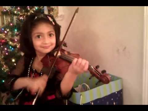 Jingle bells on violin in front of X'mas tree